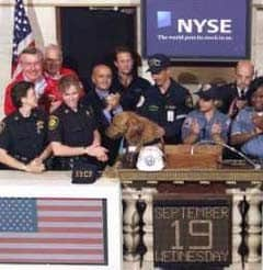 "...While inside, ""Dusty"", a SAR dog from Sacramento, rings the opening bell. (Photo: Sep 19, 2001, Reuters). (Photo: Sep 17, 2001, AP / Ted S. Warren)"