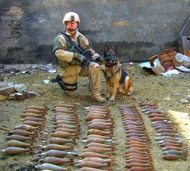 Military working dog and his handler pose for a photo in front of ...