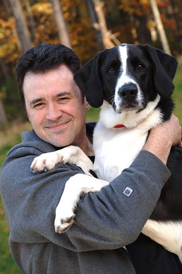 Dog Files Creator, Kenn Bell with Max, the Dog Files Mascot