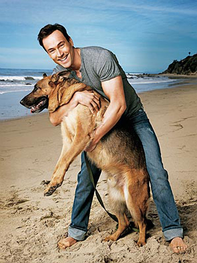 Chris Klein and his German Shepherd, Chief.
