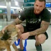 Nick and Bodhi at their happy reunion at a Florida Airport.